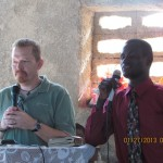 Dave sharing in a Haitian church with translator, Marc.